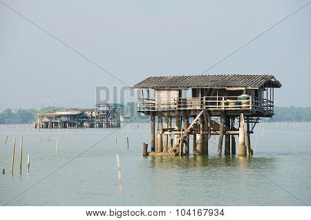 View to the stilt fishermen cabin in the gulf in Tha Thong Surat Thani province, Thailand.