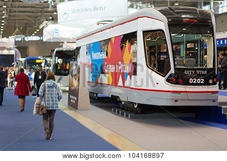 MOSCOW, RUSSIA - CIRCA NOVEMBER, 2014: People visit ExpoCityTrans exhibition. ExpoCityTrans is a unique event in the sphere of public transport consisting of an exhibition and business events.