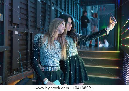 MOSCOW, RUSSIA - NOVEMBER 15, 2014: Propaganda Group makes selfie before going on stage at a party Diskach 90th in a club Space Moscow. Propaganda - Russian female pop group, founded in 2001