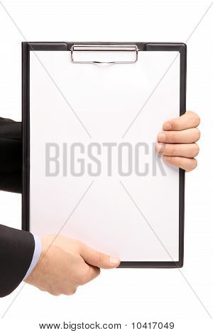 Hands Holding A Blank Clipboard