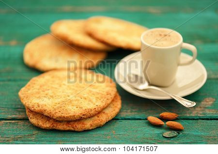 Fresh Homemade Coffee Espresso With Froth, Silver Spoon, Almond Cookies And Whole Almonds Selective