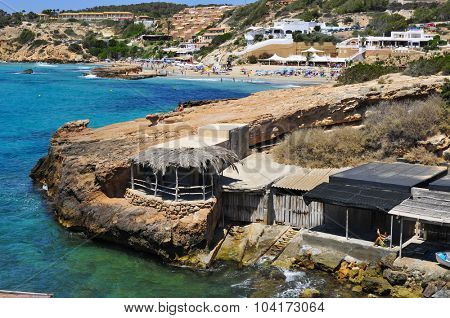 SAN JOSE, SPAIN - JUNE 15: A view of some fishermen shelters and the Cala Tarida beach on June 15, 2015, in San Jose, in Ibiza Island, Spain. Ibiza is a well-known summer tourist destination in Europe