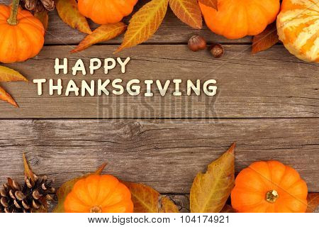 Happy Thanksgiving wooden letters with autumn double border on wood