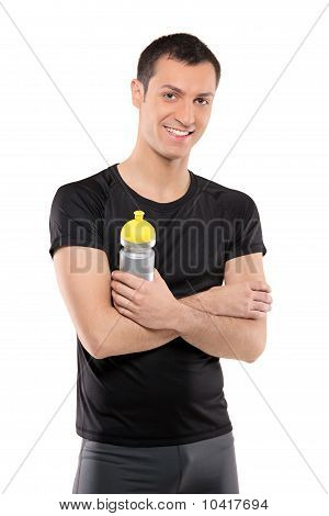 Athlete Man Posing With A Plastic Bottle In His Hand