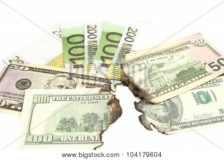 Burnt Bills Of Euro And Dollar On White