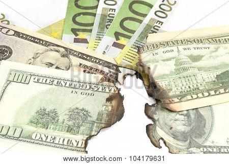 Burnt Bills Of Euro And Dollar