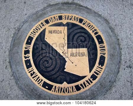 The Bronze Plaque Marks The Arizona - Nevada State Line