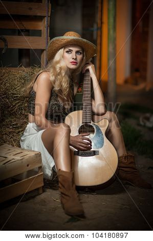 Attractive woman with country look, indoors shot, american country style. Blonde girl