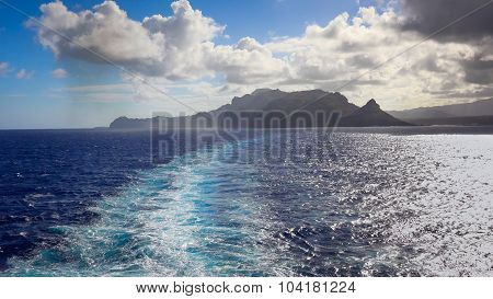 Wake Of Cruise Ship With The Island Of Kauai In The Distance