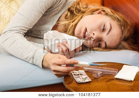 Sick Woman In Bed With Tissue And Thermometer.