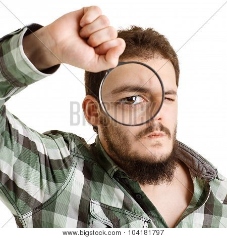 Man In Green Shirt Looking Through A Magnifying Glass.