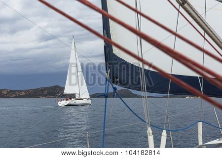 Sailing. Sailboats in sailing regatta on Aegean Sea. Ship yachts with white sails in the open Sea. Luxury boats.