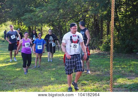 MUSKOGEE, OK - Sept. 12: Runners overcome obstacles during during the Castle Zombie Run at the Castle of Muskogee in Muskogee, OK on September 12, 2015.