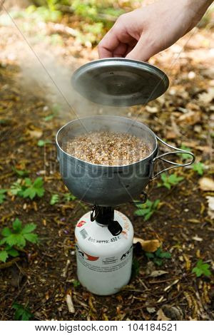 Making breakfast with a gas burner on the nature.
