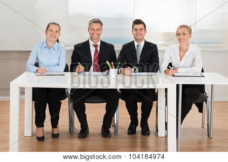 Happy Businesspeople Analyzing Graph