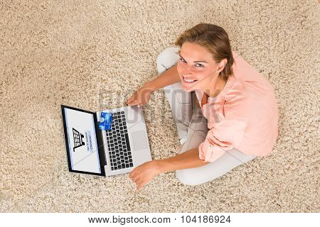 Woman Doing Online Shopping With Laptop