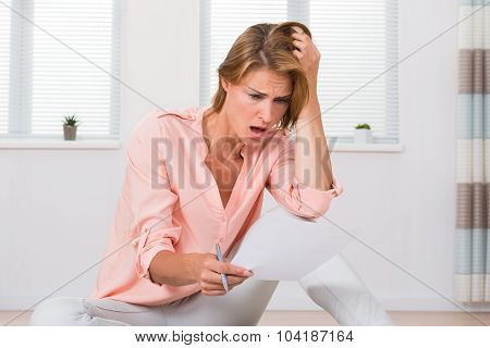 Shocked Woman Looking At Paper