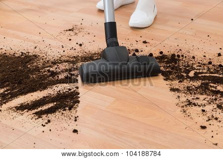Person With Vacuum Cleaner Cleaning Floor