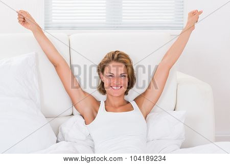 Happy Woman Stretching Arms