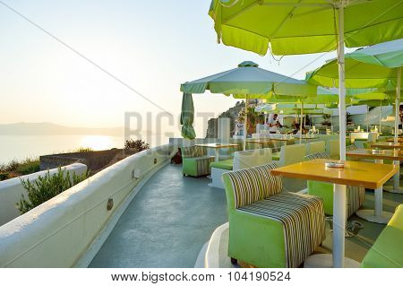 SANTORINI, GREECE - AUGUST 07, 2015: open air restaurant on Santorini island. The traditional architecture of Santorini is similar to that of the other Cyclades, with low-lying cubical houses