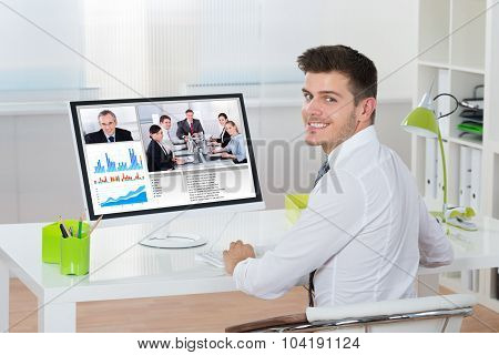 Businessman Videoconferencing On Computer