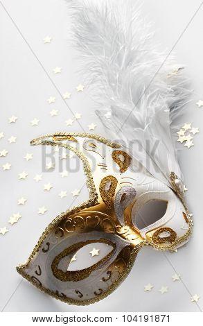 Carnival mask on light grey background