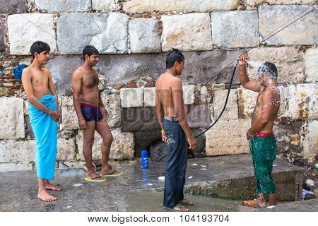 KOS, GREECE - SEP 28, 2015: Unidentified refugees wash up on the street. Kos island is located just 4 kilometers from the Turkish coast, and many refugees come from Turkey in an inflatable boats.