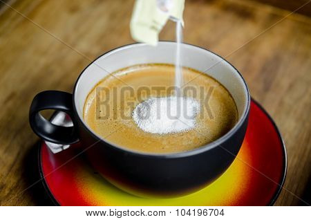 Creamer In To A Cup Of Coffee.