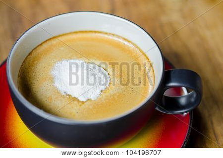 Creamer On A Cup Of Coffee