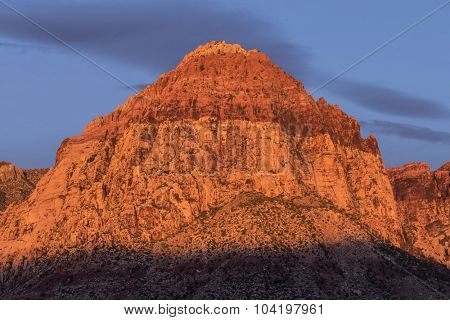 Dawn glow on Rainbow Peak at Red Rock National Conservation Area near Las Vegas, Nevada.