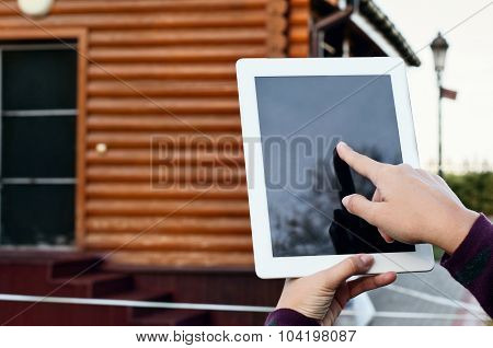 Tablet Computer In Female Hands