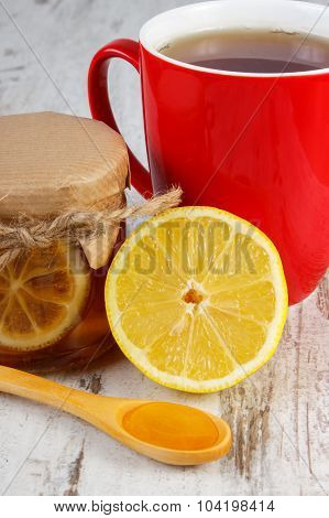 Lemon With Honey And Cup Of Tea On Wooden Table, Healthy Nutrition