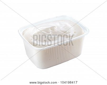 plastic container with sour cream isolated