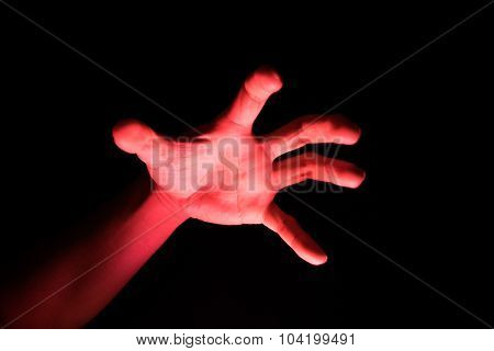 Handle Knives Reflective red light in the dark background for scary
