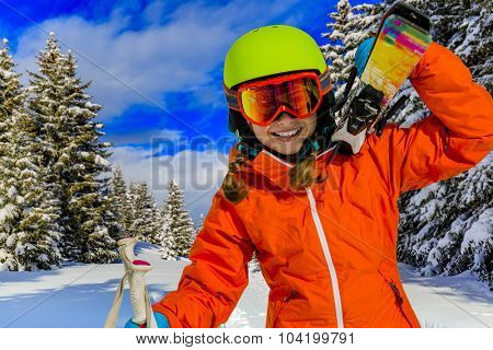Ski, winter vacation, snow, skier, sun and fun - girl enjoying ski vacations