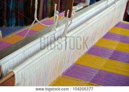 A closeup image and detail of an old weaving loom