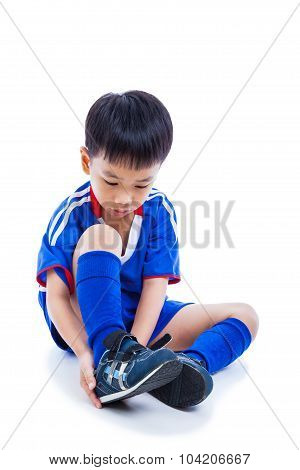 Youth Soccer Player Tying Shoe And Prepare For Competition. Full Body. Isolated On White