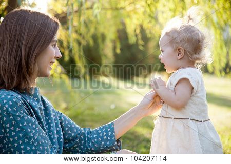 Mom Playing With Tot Daughter