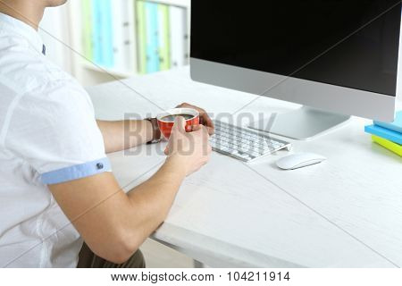 Man working with computer in office