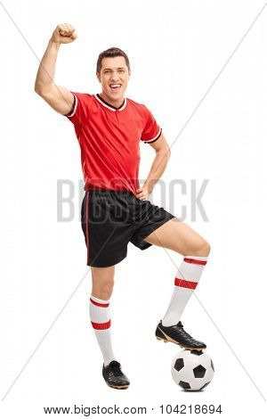 Full length portrait of a joyful football player gesturing happiness and looking at the camera isolated on white background