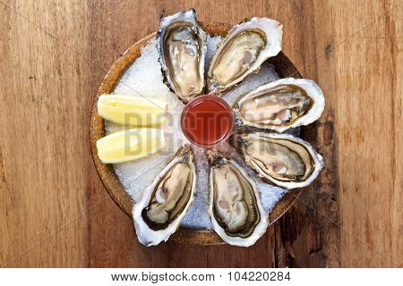 Oyster On Round Wooden Bowl