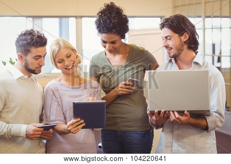 Business creative team using tablet pc in office