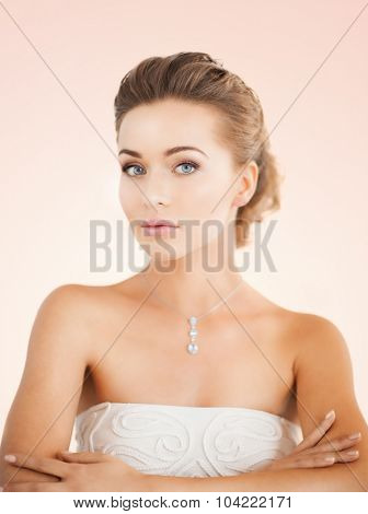 beautiful woman in white dress with diamond necklace