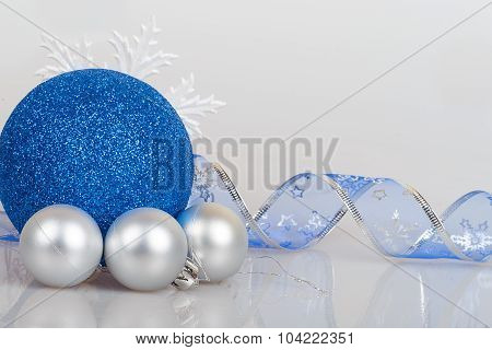 Blue Christmas Balls With White Snowflakes And Ribbon