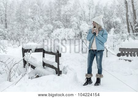 Woman with cup stay outdoor at winter