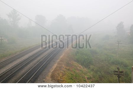 Railroad Track And Mist