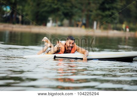 Handsome Wet Man On Paddleboard