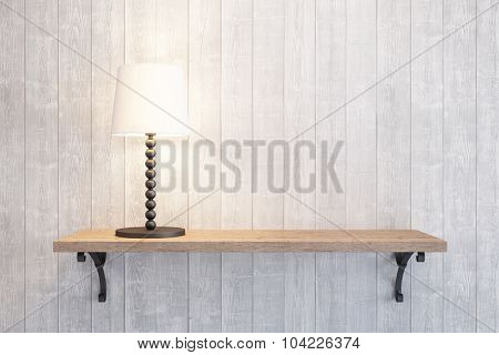 turn on table lamp on the shelf