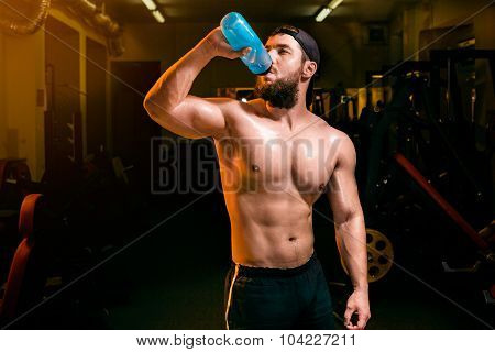 man in the gym with shaker