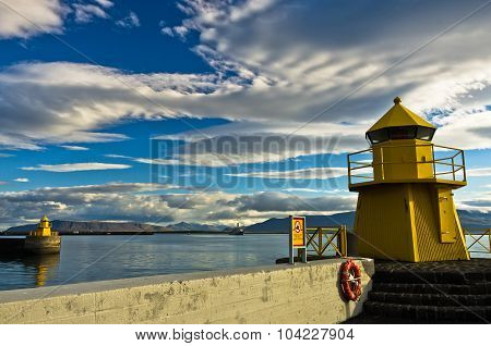 Yellow lighthouse at the entrance of Reykjavik harbor at early morning